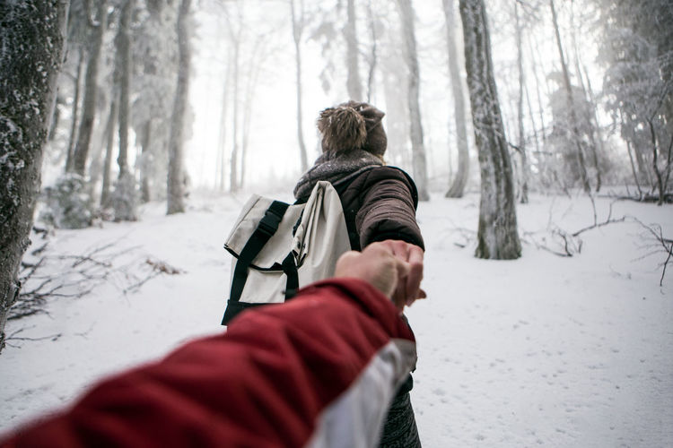 Couple In Snow Covered Forest