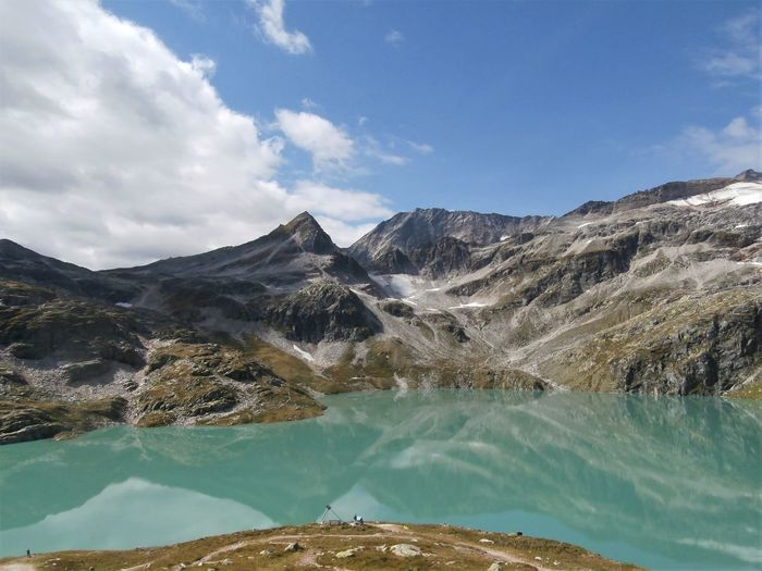 Magnificent glacier lake. Mountain Scenics - Nature Sky Cloud - Sky Beauty In Nature Environment Landscape Nature Mountain Range Water Day Rock Non-urban Scene No People Mountain Peak Outdoors Lake Lake View Mountain Lake Summer Summertime Austria Green Color Blue Alps