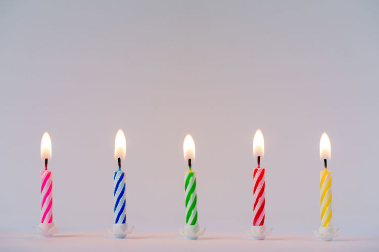 Lit birthday candles Anniversary Birthday Birthday Candles Candle Celebration Event Flame Illuminated Indoors  Lit Candles Lit Candles On White Background Neutral Background White Background