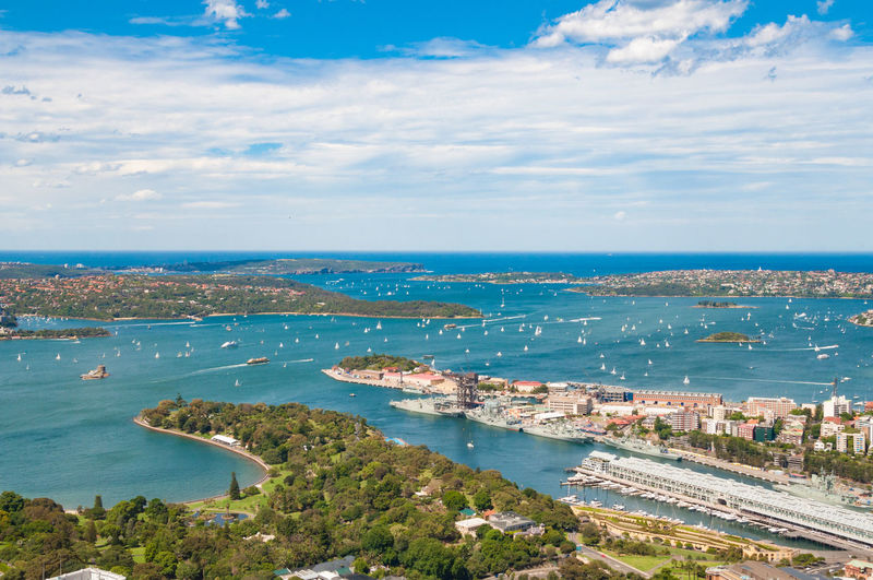Aerial view of picturesque Sydney Harbour with view of Royal Botanic Gardens, Woolloomooloo and Vaucluse suburbs on sunny day. Sydney, Australia Woolloomooloo Sydney Australia Aerial View City Urban Vaucluse Harbor Sydney Harbour  Royal Botanic Gardens Water Sea Sky Architecture Cityscape Coastline Horizon Over Water Scenics - Nature High Angle View Nature