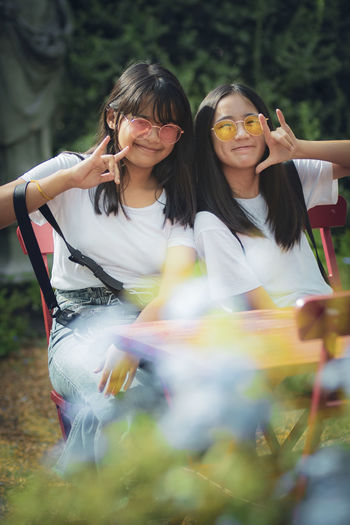 Portrait of smiling girls sitting outdoors