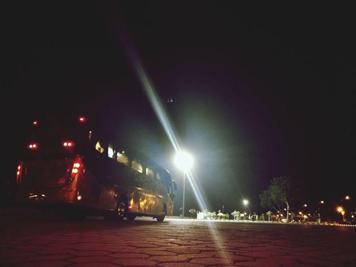 View of illuminated street at night