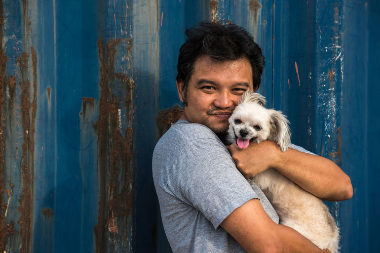 Portrait Of Happy Man With Dog