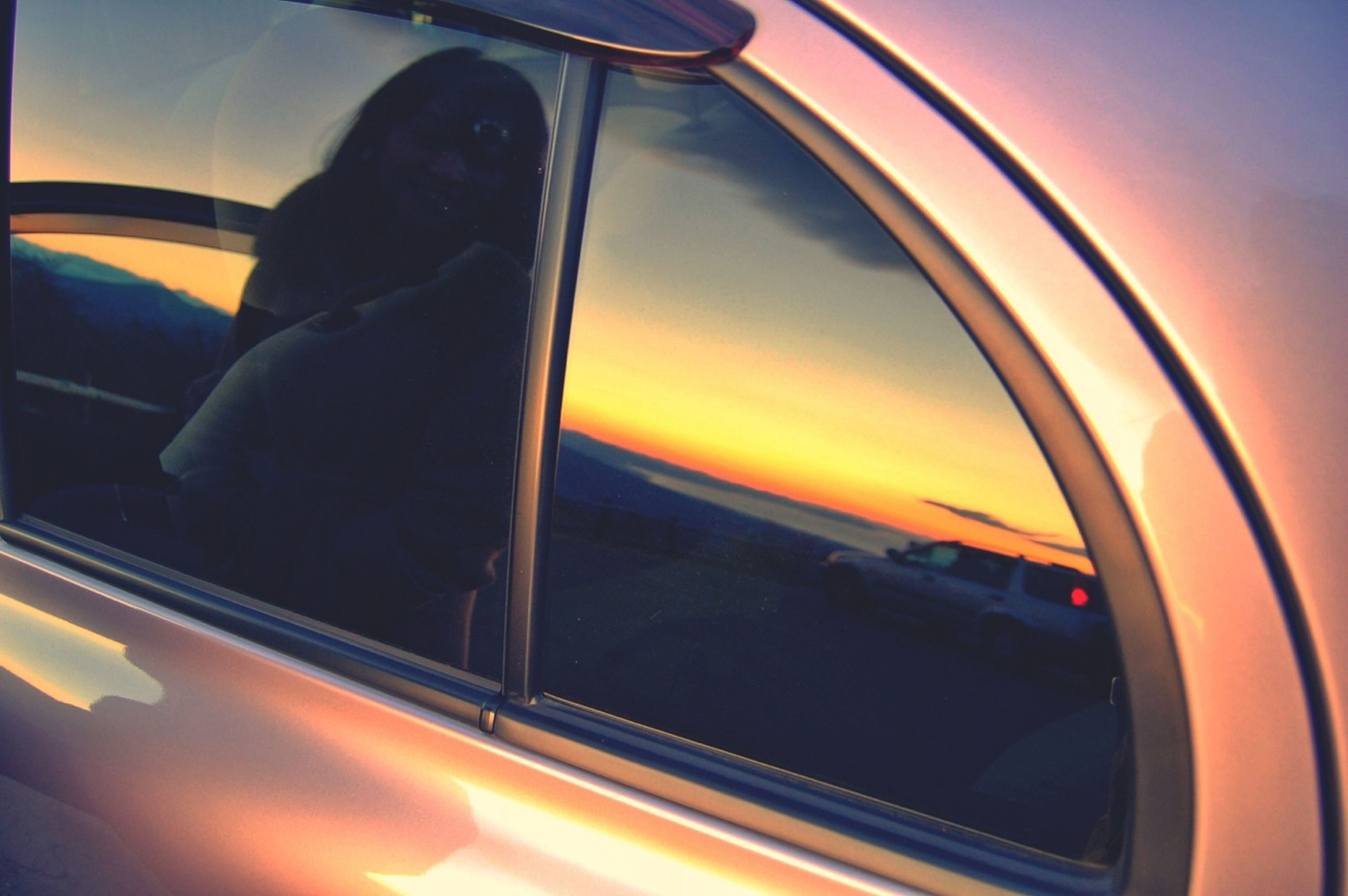 transportation, mode of transport, sunset, land vehicle, car, orange color, vehicle interior, window, glass - material, travel, on the move, transparent, part of, indoors, sky, sun, reflection, silhouette, public transportation, airplane