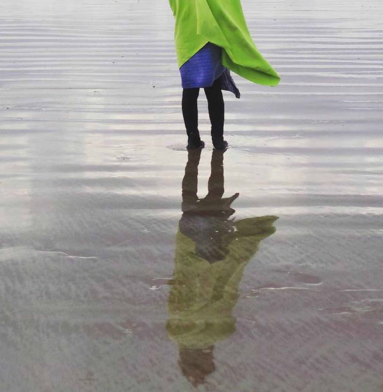 water, walking, real people, low section, reflection, one person, wet, outdoors, standing, leisure activity, day, lifestyles, childhood, beach, nature, people