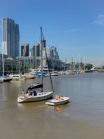 Yacht Sailboat Yacht Harbor Madero Harbor Puerto Madero River Water Boat Skyscrapers City Life Cityscape Nautical Vessel Mode Of Transport Transportation Architecture Harbor Built Structure Building Exterior City Waterfront Moored Sea Outdoors No People Mast Day Sky Yacht Sailing