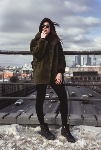 Full Length One Person One Woman Only People Sky Cloud - Sky Outdoors Day Real People City Life Russia Moscow Life Moscow City Urban Style Shades Urban Fashion Urbanphotography Urban Lifestyle Beautiful Woman Cold Temperature Warm Clothing Winter City Smoking