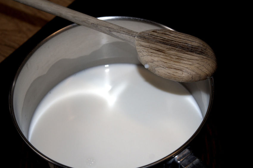 Heating the milk. Abstract Bowl Close-up Composition Cropped Directly Above Food Food And Drink Healthy Eating Ideas Indoors  Making Bread Overhead View Part Of Preparation  Shiny Spoon Still Life Table Wood Wooden