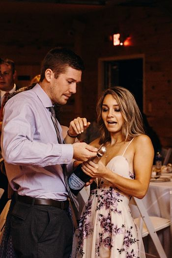 Two People Men Women Real People Adult Lifestyles Indoors  Couple - Relationship Females Young Men Love Standing Casual Clothing Leisure Activity Young Adult Sitting Three Quarter Length Togetherness People