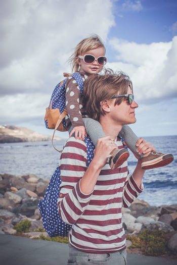 God bless America 2yearsold  American Flag Blonde Girl Casual Daddy Daddysgirl Family Time FamilyTime Kids Kids Being Kids Kidsphotography Lifestyles On The Shoulders Portrait Sunglasses