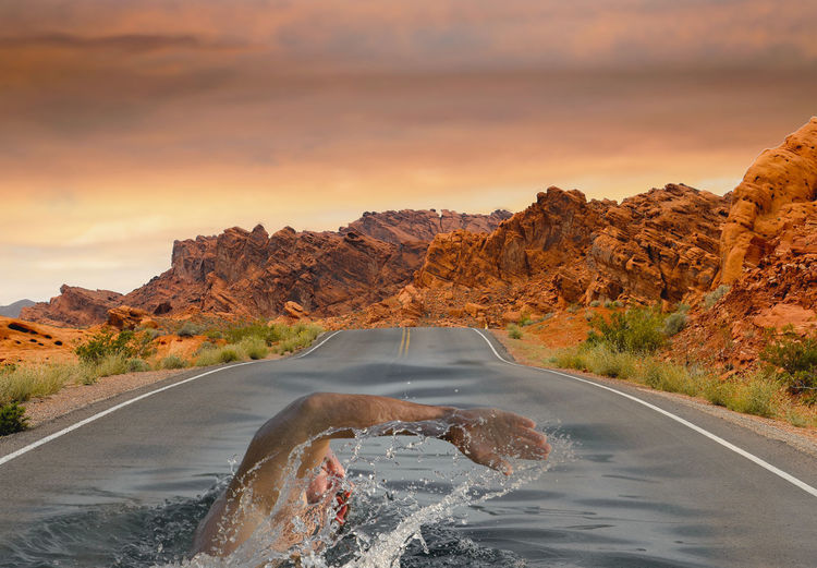 Swimming on the road Sky Transportation Beauty In Nature Road Water Scenics - Nature Nature Cloud - Sky Sunset Mountain No People Rock Formation Non-urban Scene Rock - Object Rock Mode Of Transportation Orange Color Car Tranquil Scene Outdoors Sport Swimming Collage EyeEmNewHere My Best Photo
