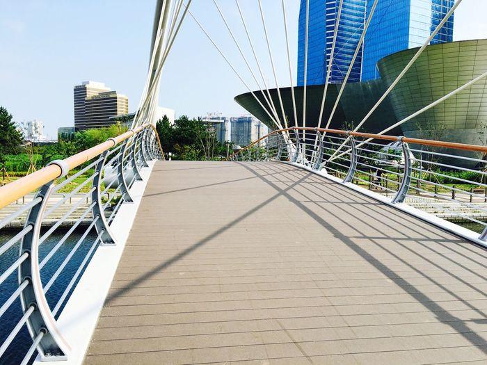 View of footbridge in city