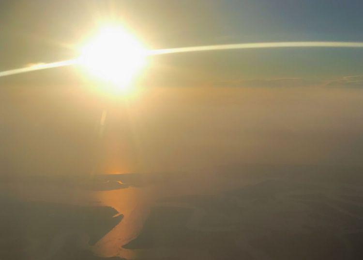 Orange and pink sunrise over the ocean. Sun Lens Flare Sunbeam Sunlight Ocean Sunrise Over Water Sky Horizontal