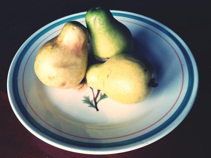 Three pears on plate