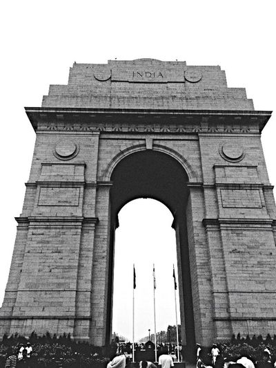 The India gate , is a war memorial . Architecture Built Structure History Low Angle View Outdoors Building Exterior Tourism Triumphal Arch Monument Sculpture IPhoneography Wanderlust Travel Photography