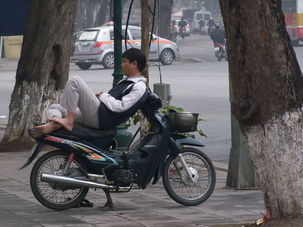 Taking a Break! Casual Clothing Close Up Composition Day Full Frame Full Length Hanoi Land Vehicle Leisure Activity Lifestyles Mode Of Transport Motorcycle No Incidental People No Shoes Outdoor Photography Outdoors Parked Resting Road Stationary Transportation Tree Trunks Vietnam Vietnamese Man