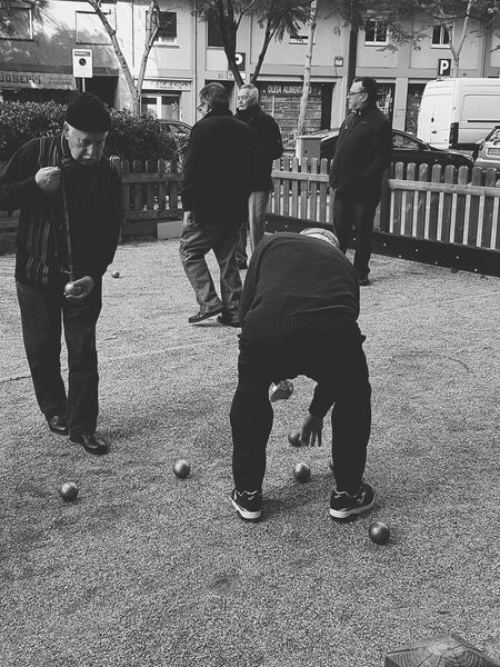 Jugando a la petanca..2... Men Only Men City Real People People Adults Only Adult Outdoors Day Grandparents Old Man Catalunya Barcelona Playtime Petanca City Petanque Time Uniqueness The Week Of Eyeem