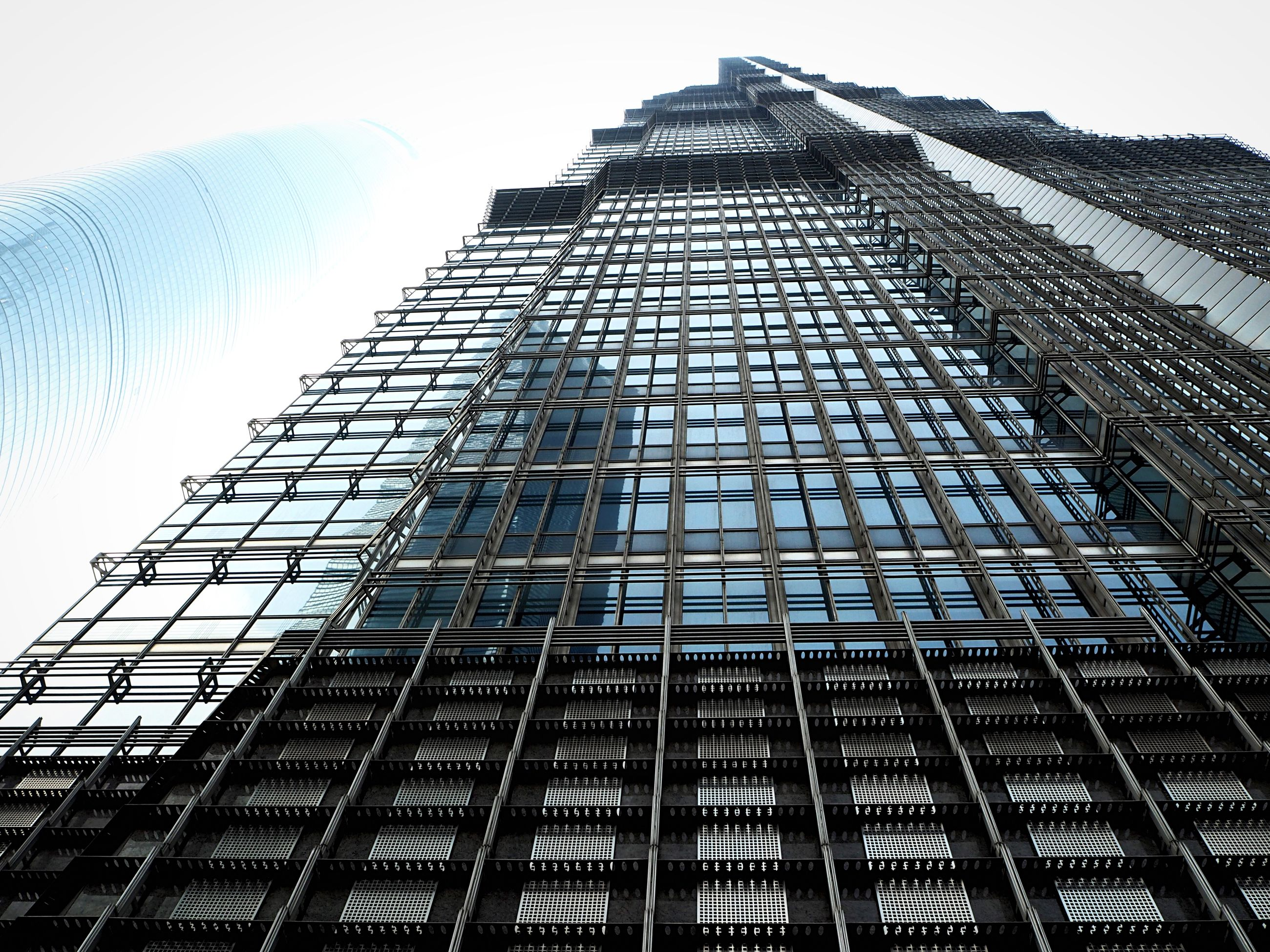 architecture, building exterior, built structure, low angle view, tall - high, modern, skyscraper, tower, office building, city, building, clear sky, sky, day, window, glass - material, tall, no people, outdoors, architectural feature