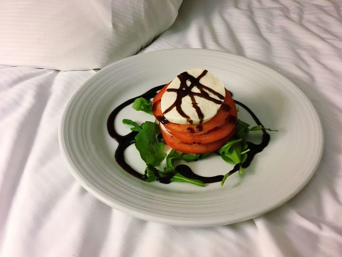 High angle view of food in plate on bed