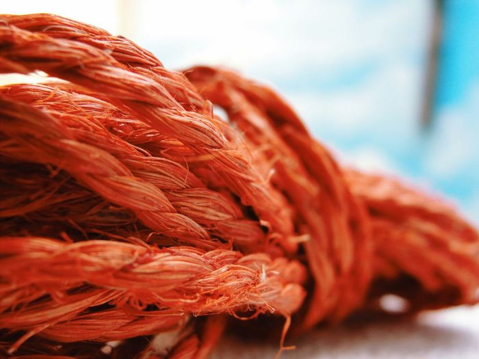 Close-Up Of Orange Weathered Rope