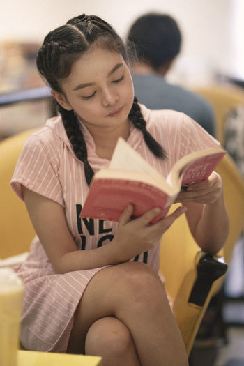 A reader lives a thousand lives before she dies... Eyeem Philippines Pink Reading The Week on EyeEm Book Girl Pink Book Reading & Relaxing Reading A Book