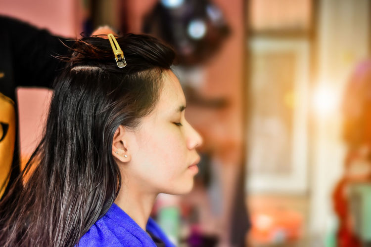 Long hair woman washing hair in hair salon,Asian woman washing in hair salon. Close-up Day Focus On Foreground Headshot Indoors  One Person People Profile View Real People Side View Young Adult