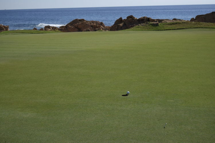 Golf Day Golf Golf Ball Golf Club Golf Course Golfer Grass Green - Golf Course Green Color Hole Landscape Leisure Activity Nature No People Outdoors Putting Putting Green Scenics Sky Sport Taking A Shot - Sport