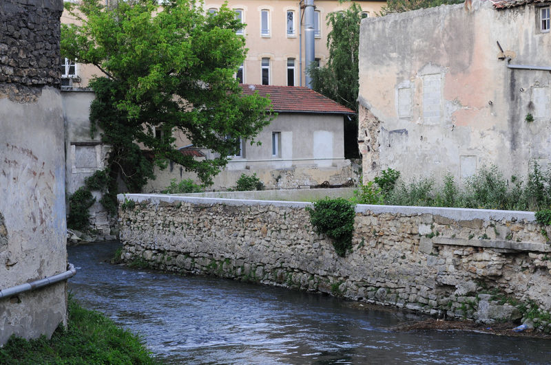 The river Meyne flowing through the town of Orange City France Orange Built Structure Flowing Water Meyne River River Town Water