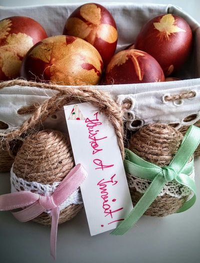 Close-up of easter eggs in basket on table
