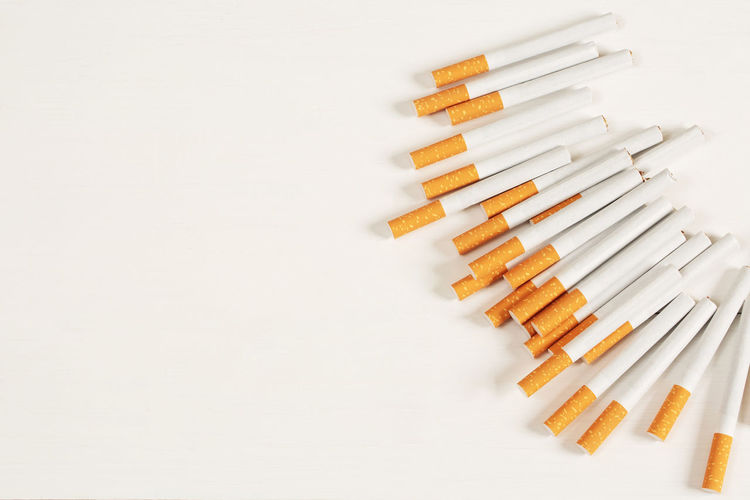 High angle view of pencils on white background