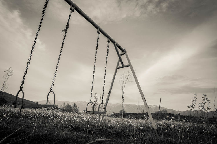 Old swing.. Uludağ/Milli Park Architecture Built Structure Cloud - Sky Day Environment Field Football Grass Gököz Land Landscape Low Angle View Metal Nature No People Outdoor Play Equipment Outdoors Plant Playground Sky Swing Tranquility First Eyeem Photo