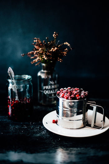 Cranberries on powdered sugar shaker