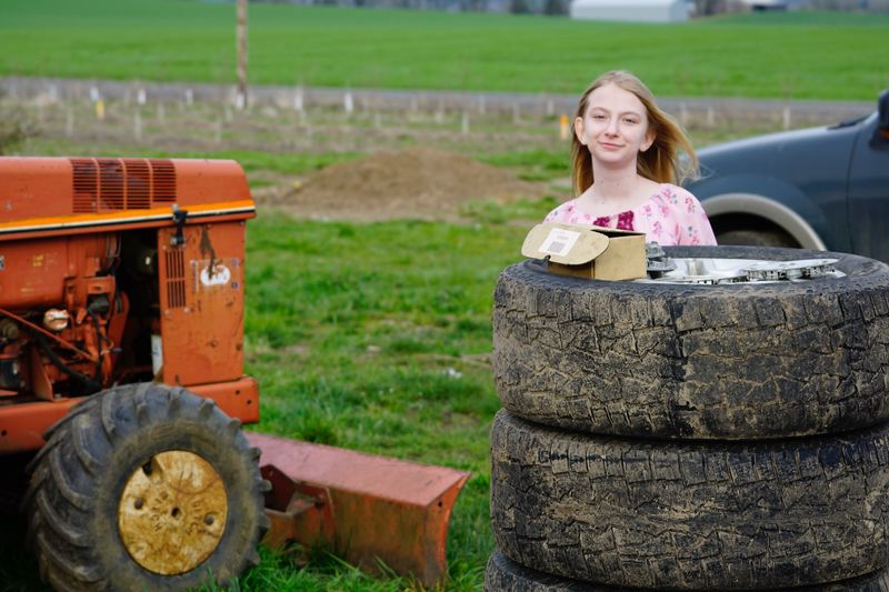 Partner Collection Selected For Partner EyeEm Selects One Person Smiling Adult Portrait Young Adult Looking At Camera Agricultural Equipment Young Women Agriculture Transportation Nature Focus On Foreground Plant Front View Women Land Vehicle Field Day Beautiful Woman Outdoors