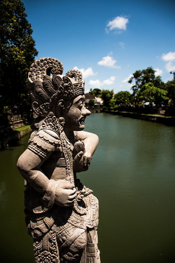 Bali Worship Hinduism Sculpture Art And Craft Statue Representation Religion Belief Human Representation Spirituality Creativity Nature Day No People Architecture Water Craft Sky Tree Plant