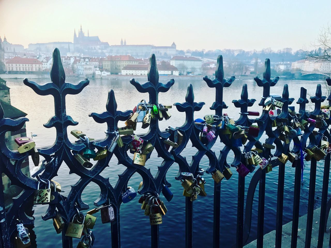 water, metal, railing, outdoors, river, day, padlock, tourism, travel destinations, no people, clear sky, architecture, sky, love lock, city, nature, animal themes, close-up