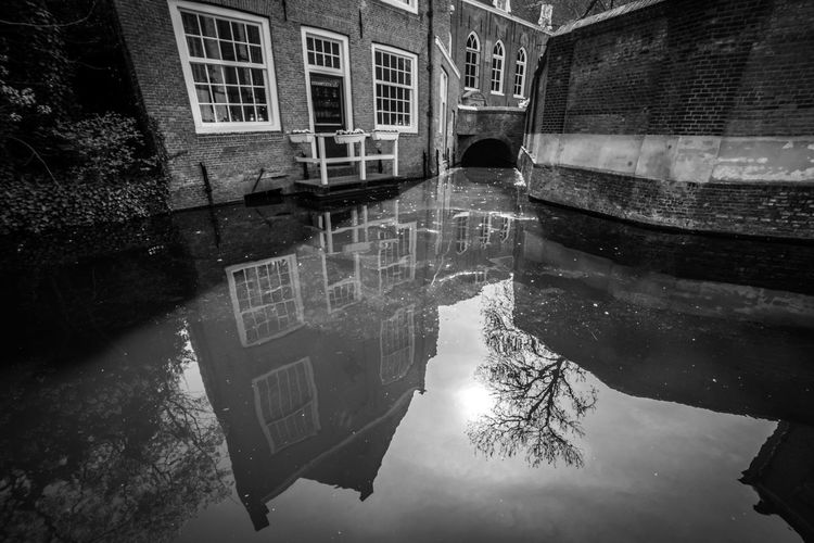 Old Gouda Building Exterior Built Structure Reflection Architecture Water Building Waterfront Puddle City Nature Residential District Day No People Canal Tree Standing Water Symmetry Window Outdoors Digital Composite
