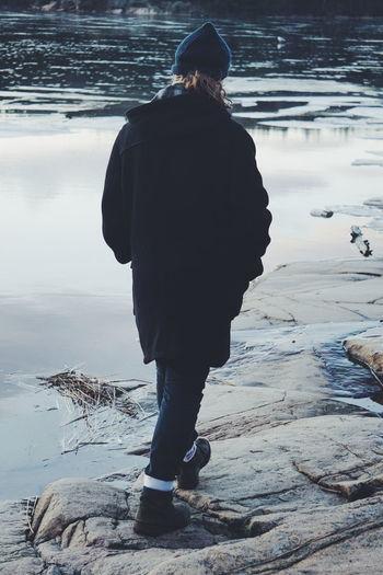 Rear View Of Women Walking By Lake
