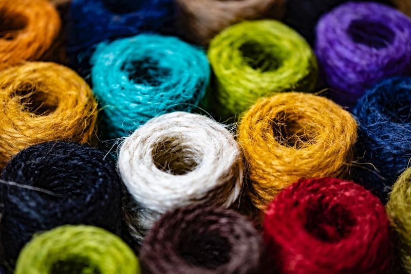 thread spools Multi Colored Textile Art And Craft Thread No People Still Life Backgrounds Spool Sewing Item Wool Textile Industry Close-up