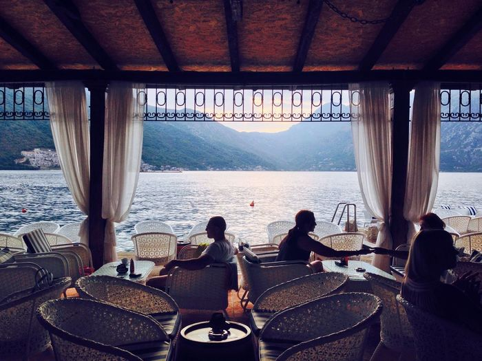 People sitting in restaurant by sea