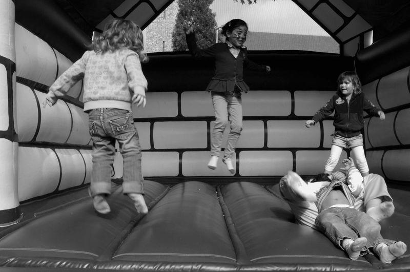 Friends Playing In Bouncy Castle