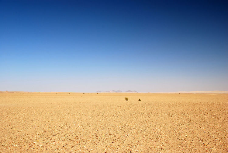 Not Much Arid Climate Beauty In Nature Blue Distant Horizon Over Land Idyllic Landscape Nature Non-urban Scene Outdoors Remote Sand Scenics Solitude Summer Tranquil Scene Tranquility
