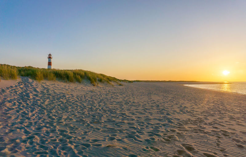 Ellenbogen, Sylt Lighthouse, Sylt Sylt, Germany Beach Beauty In Nature Clear Sky Day Ellenbogen, Sylt Horizon Over Water Lighthouse Nature No People Outdoors Sand Sand Dune Scenics Sea Sky Summer Sun Sunset Tranquility Water