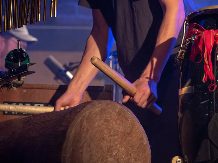 Concert Photography Music Slit Drum Arts Culture And Entertainment Concert Drum - Percussion Instrument Drummer Hand Holding Human Body Part Human Hand Indoors  Midsection Music Musical Equipment Musical Instrument Musician Occupation People Percussion Playing Real People
