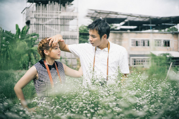 Two People Architecture Togetherness Plant Men Building Exterior Built Structure Growth Water Emotion Nature Adult Day Real People Lifestyles Bonding Young Adult Males  Garden Hose Gardening Outdoors Positive Emotion Couple