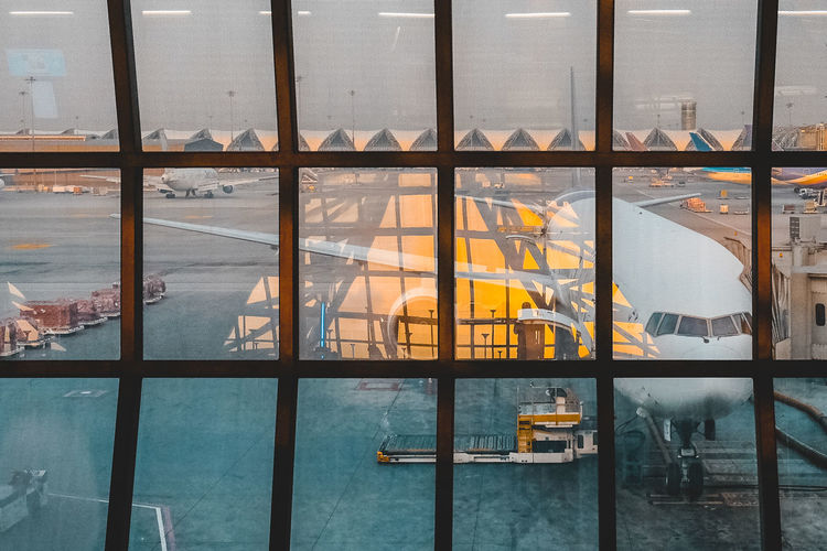 Architecture Mode Of Transportation Transparent Transportation Window Glass - Material No People Travel High Angle View Built Structure Industry Orange Color Airport Airport Terminal Departure