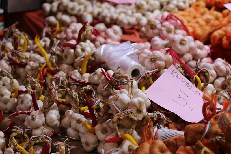 High angle view of fresh garlic cloves with label at market stall