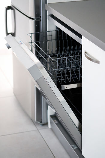Dishwasher Electric Equipment Build-in Build In Lifestyle Object Smart House Modern Machine Shelf Shelves Indoors Inside Clean Cabinet Fresh Freshness Home Appliance Metal Metallic Domestic Room Easy Usage Nobody No People Empty Basket Everyday Chores Open Door Closeup Side View Counter Top Vertical Image Cleaner Control Cutlery Digital Dish Dishware Dishwashing Household Housekeeping Housework Hygiene Inside Kitchen Kitchenware Load Panel Plate Routine Side Silverware  Stainless Tableware Technology Utensil Wash Washer White Work