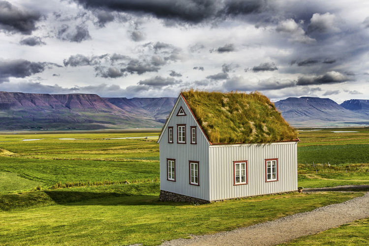 Glaumbær in Skagafjörður, Iceland Hringvegur Church Clouds Farm Folk Museum Glaumbaer Glaumbær Green Historical Building House Iceland Lanscape Moss Museum Peat Ringstrasse Skagafjörður Torfhaus Turf Farm Vinland First Eyeem Photo