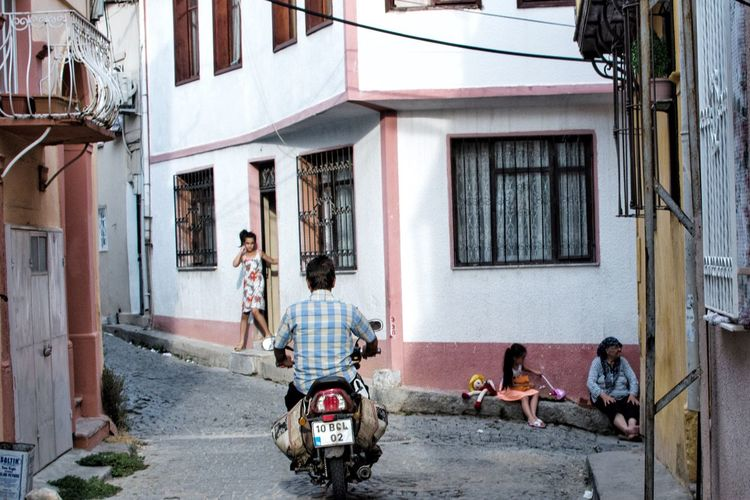 Ayvalık Building Exterior Built Structure Architecture Real People Street Outdoors Day Men House Residential Building Rear View Transportation Land Vehicle Motorcycle City Scooter Adult People