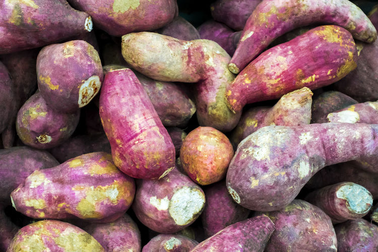 isolated fresh sweet potatoes (Ipomoea batatas) Is a plant that utilizes the root. Healthy Eating Freshness Organic Diet Delicious Nutrition Vegetable Ingredient Vegetarian Raw Food Sweet Closeup Natural Plant Object Nobody Group Assorted Sweets Tasty Cooking Cuisine Health Material Salad Gourmet Eating Vitamin Root Isolated Isolated White Background Food And Drink Agriculture Cultivated Nature Harvested Traditional Market Red Crop  Pile Nutritious Whole Vitamins Food Large Group Of Objects Market Stall Ripe Close-up Fruit Purple